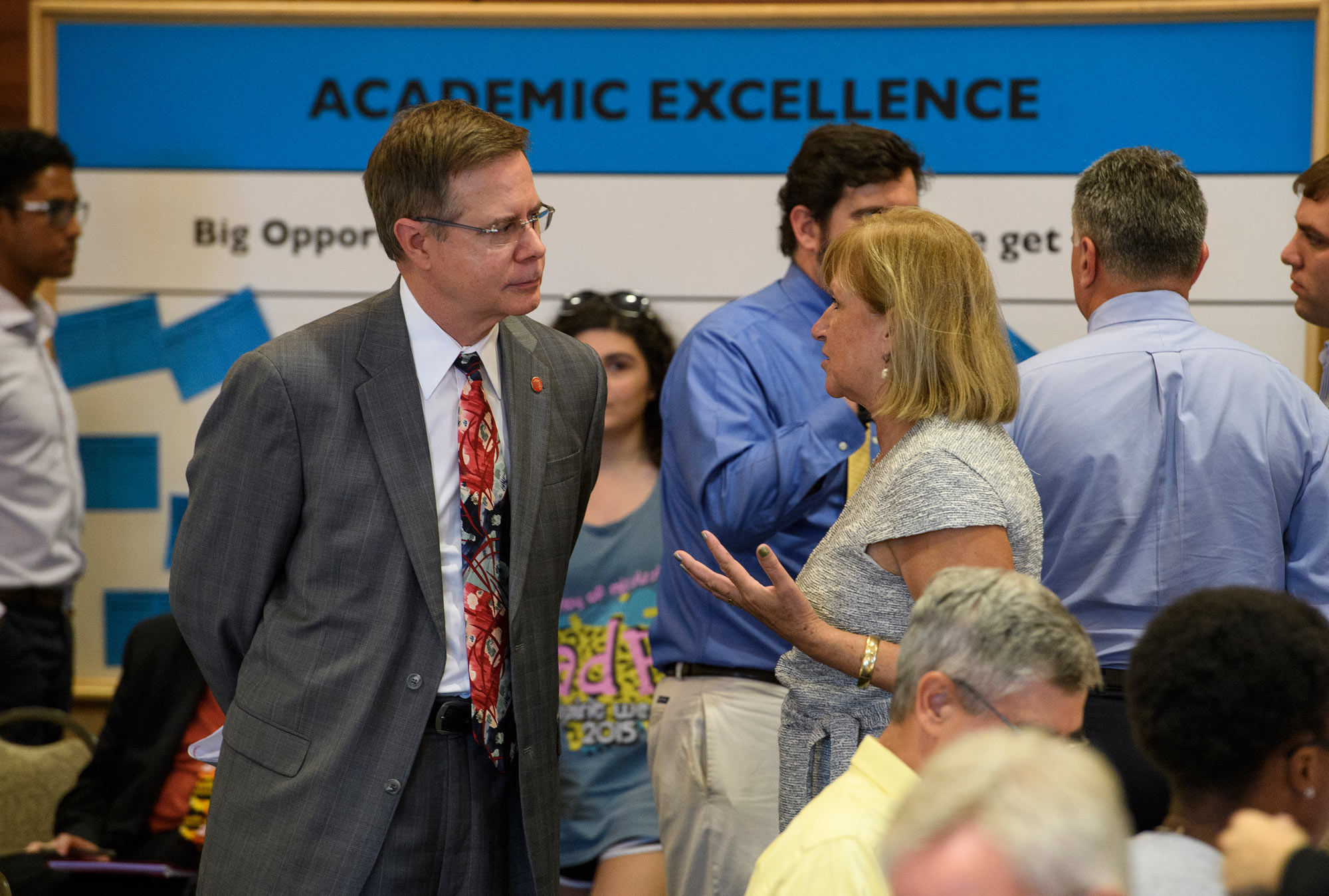 Chancellor Jeff Vitter speaks with woman at Town Hall Meeting